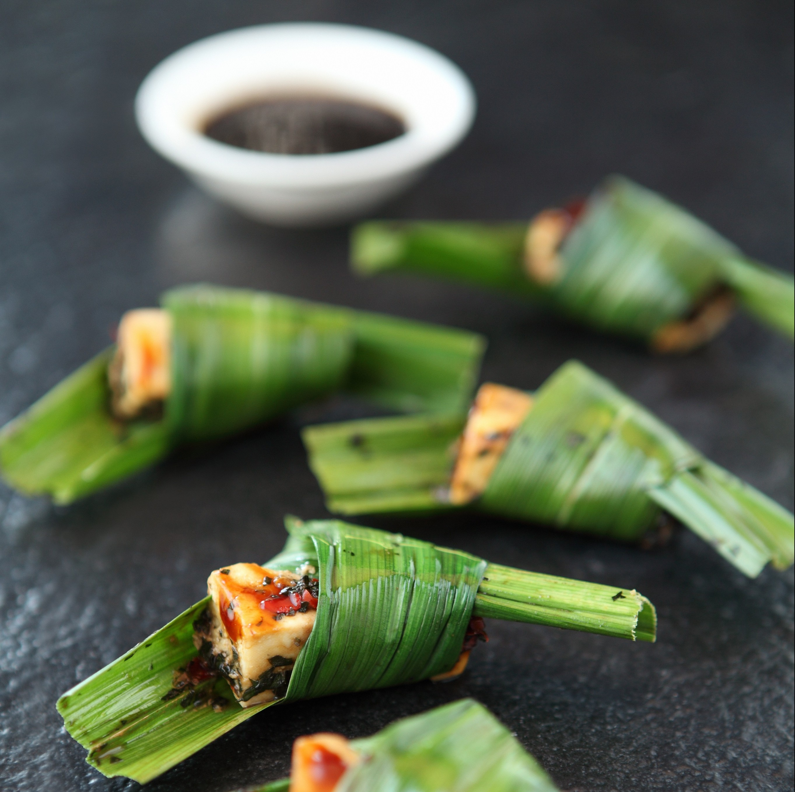 Pandan Leaf Wrapped Spiced Cottage Cheese - served with coriander chilli soy
